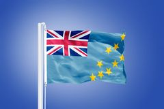 Flag of Tuvalu flying against a blue sky Royalty Free Stock Images