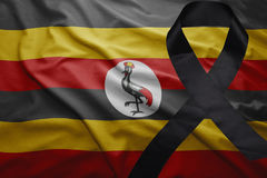 Flag of uganda with black mourning ribbon Royalty Free Stock Photography