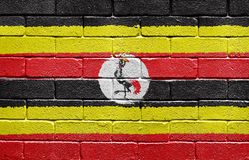 Flag of Uganda on brick wall Stock Images