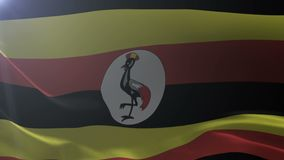 Flag of Uganda waving on flagpole in the wind, national symbol of freedom. Stock footage stock video