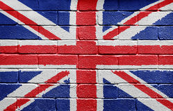 Flag of the UK on brick wall. Flag of the United Kingdom painted onto a grunge brick wall Royalty Free Stock Images