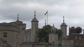 Uk  flag on top of the castle. The flag of the UK flying over Tower castle stock video footage