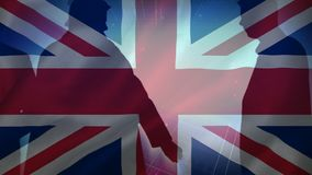 Flag of the UK and men walking. Animation of the flag of the UK in the background of men walking on the street stock footage