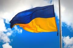 Flag of Ukraine. Against a blue cloudy sky stock photos