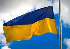 Flag of Ukraine. Against a blue cloudy sky royalty free stock photo