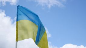 Flag of Ukraine on blue sky background stock footage