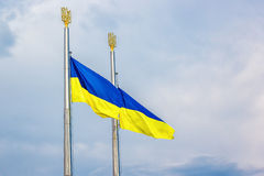 Flag of Ukraine fluttering in the wind against blue sky. Royalty Free Stock Photography