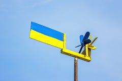 Flag of Ukraine fluttering in the wind against blue sky. Stock Images
