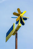 Flag of Ukraine fluttering in the wind against blue sky. Royalty Free Stock Photos