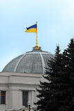 The flag of Ukraine over the Parliament of the country Royalty Free Stock Photo