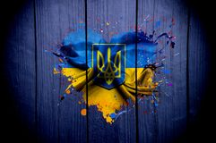 Flag of Ukraine in the shape of heart on a dark background vector illustration