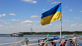 Flag of Ukraine and the ship. Flag of Ukraine, beautiful clouds, a wide river and a ship going into the distance stock video footage