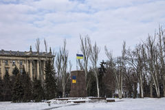 Flag of Ukraine stands on a pedestal. Ukrainian city Royalty Free Stock Photo