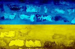 Flag of Ukraine on a textured brick wall. Horizontal frame Stock Image