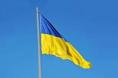 Flag of Ukraine. Waving against blue sky stock photos