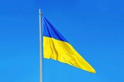 Flag of Ukraine. Waving against blue sky stock images
