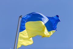 Flag of Ukraine waving in the air Stock Photography