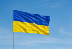 Flag of Ukraine. Waving flag of Ukraine on a sky background Stock Photo