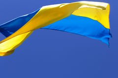 Flag of Ukraine waving in wind on clear blue sky Royalty Free Stock Photos