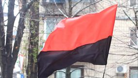 Flag of the Ukrainian Insurgent Army red-black fluttering in the wind.  stock video footage