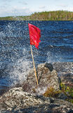 Flag under a strong wind Stock Images
