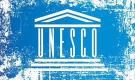 Flag of UNESCO, United Nations Educational, Scientific and Cultural Organization. Wrinkled dirty spots. Can be used for design, stickers, souvenirs stock illustration