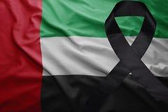 Flag of united arab emirates with black mourning ribbon. Waving national flag of united arab emirates with black mourning ribbon Stock Photo