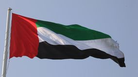 Flag of the United Arab Emirates. National Flag of the United Arab Emirates waving in the wind stock footage