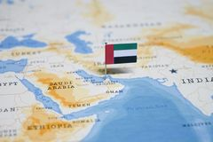 The Flag of united arab emirates in the world map royalty free stock image