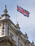 Flag of the United Kingdom at Downing Street. The United Kingdom flag flies over a beautiful ornate building on Downing Street in London Stock Photos