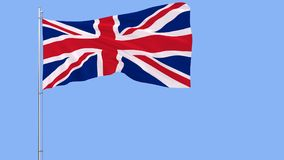 Flag of United Kingdom on a flagpole fluttering in the wind on blue background, 3d rendering Stock Photography