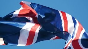 Flag of the the United Kingdom of Great Britain and Northern Ireland waving Stock Photo