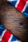 Flag of United Kingdom  on old wooden background. Union Jack  flag on old oak background.  Royalty Free Stock Photos