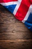 Flag of United Kingdom  on old wooden background. Union Jack  flag on old oak background.  Stock Image