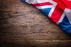 Flag of United Kingdom  on old wooden background. Union Jack  flag on old oak background.  Royalty Free Stock Photography