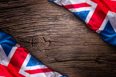 Flag of United Kingdom  on old wooden background. Union Jack  flag on old oak background Royalty Free Stock Photos