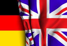 Flag of United Kingdom over the German flag. Royalty Free Stock Photos