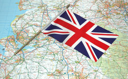 Flag of United Kingdom over the map. Flag of United Kingdom over map Royalty Free Stock Photo