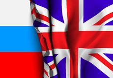 Flag of United Kingdom over the Russia flag. Royalty Free Stock Photo