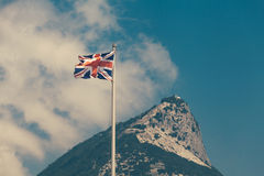 The flag of the United Kingdom and the Rock of Gibraltar Stock Images