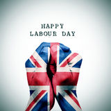 Flag of the United Kingdom and the text happy labour day. Man hand patterned with the flag of the United Kingdom put together and the text happy labour day, with Stock Photography