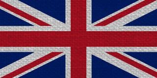 flag of the United Kingdom (UK) aka Union Jack with fabric texture stock image