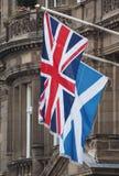 Flag of the United Kingdom (UK) aka Union Jack and flag of Scotland. National flag of the United Kingdom (UK) aka Union Jack and flag of Scotland stock photos