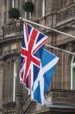 flag of the United Kingdom (UK) aka Union Jack and flag of Scotland royalty free stock photos
