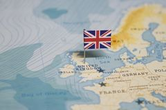 The Flag of United Kingdom, UK in the world map royalty free stock photos