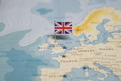 The Flag of United Kingdom, UK in the world map royalty free stock image