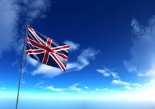 Flag of United Kingdom under blue sky Stock Photo