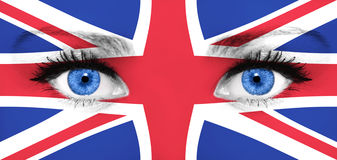 Flag of the United Kingdom on the woman's face. With blue eyes Stock Photo