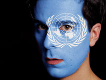 Flag of United Nations. Painted on a Face of a Young Man Stock Photo