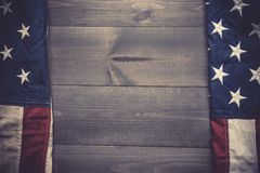 The flag of the United Sates on a grey plank background with copy space royalty free stock photos
